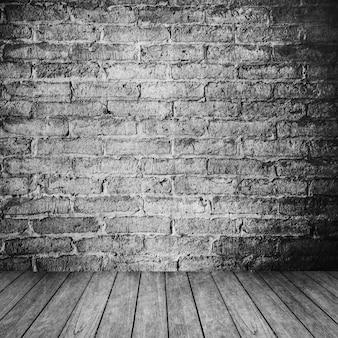 Vintage interior de sala com parede de tijolo branco e fundo do assoalho de madeira