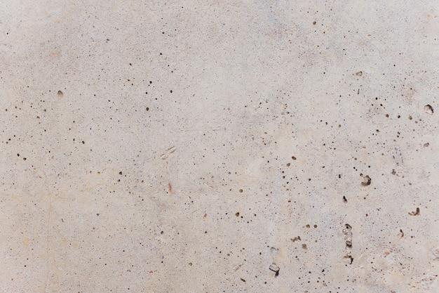 Vintage ou fundo branco sujo do cimento natural ou textura velha de pedra como uma parede retrô padrão. é um conceito, banner de parede conceitual ou metáfora, grunge, material, idade, ferrugem ou construção.