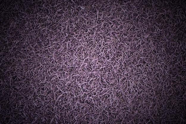 Vintage violeta ou grama roxa e textura arquivado fundo em tom escuro