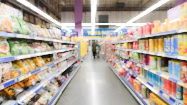 Visão ampla turva movimento de loja de departamento de supermercado na china