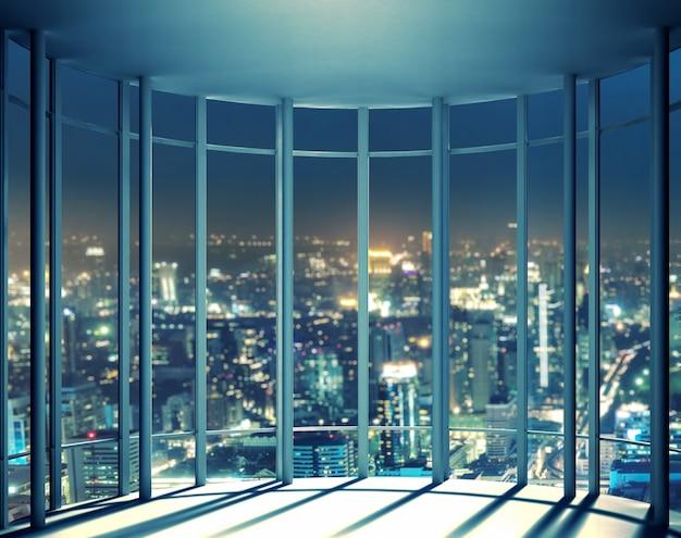 Visão noturna de edifícios da janela do prédio