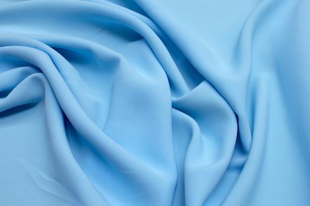 Viscose de tecido (rayon). a cor é azul claro. textura,
