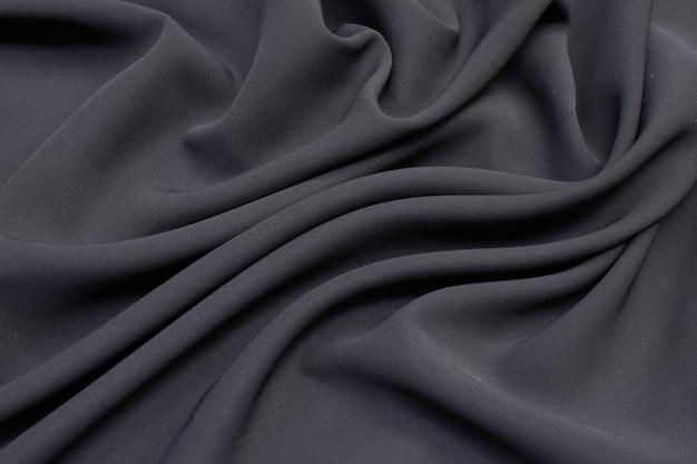Viscose de tecido (rayon). a cor é cinza. textura,