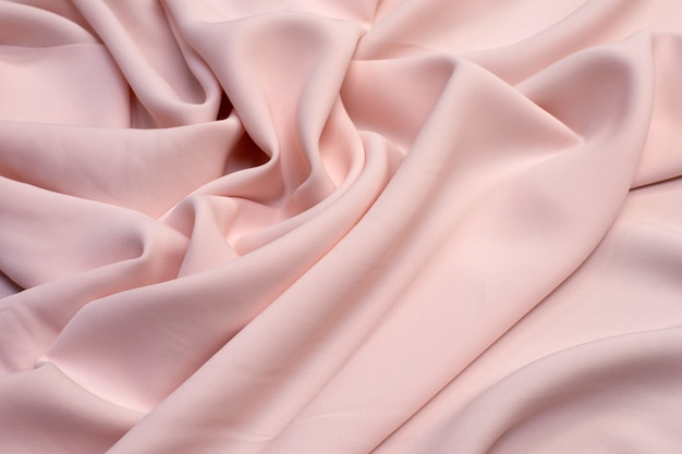 Viscose de tecido (rayon). a cor é rosa claro. textura,