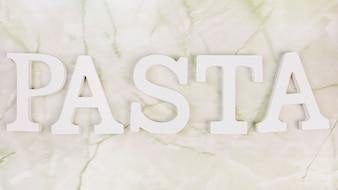 Vista alta ângulo, de, branca, palavra macarronada, ligado, mármore