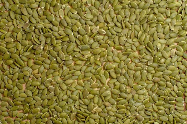 Vista de cima de sementes de abóbora verdes, sementes, sementes, muitos verdes