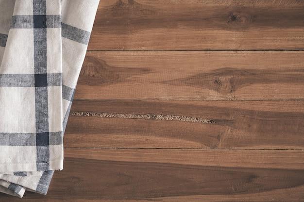 Vista de cima do guardanapo no fundo de madeira velho vazio