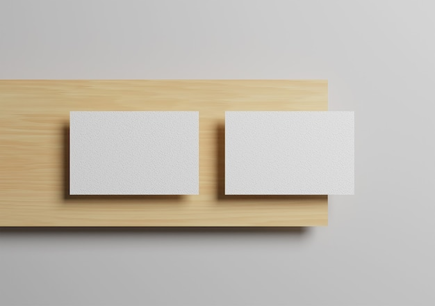 Vista de cima em branco e elegante foto maquete de cartão de visita na madeira