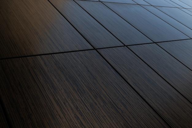 Vista diagonal da superfície da parede de azulejo de vingança marrom escuro, textura de imitação de madeira