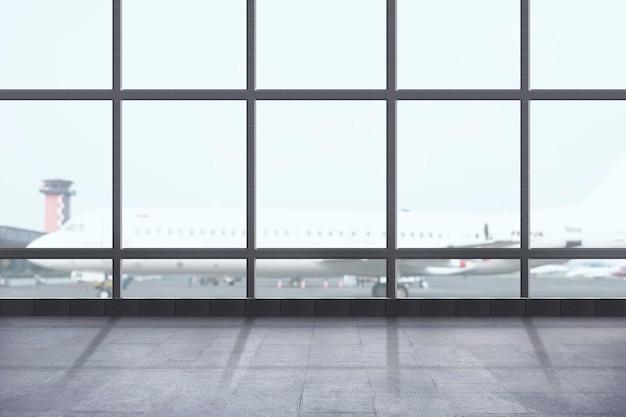 Vista do terminal do aeroporto com o avião na pista