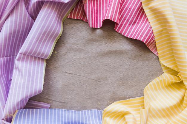 Vista elevada, de, têxteis, com, listras, padrão, formando, quadro