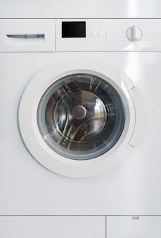 Vista frontal da máquina de lavar - fundo em tela inteira