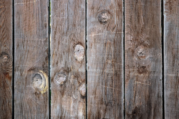 Vista frontal da textura de prancha de madeira velha com padrão vertical