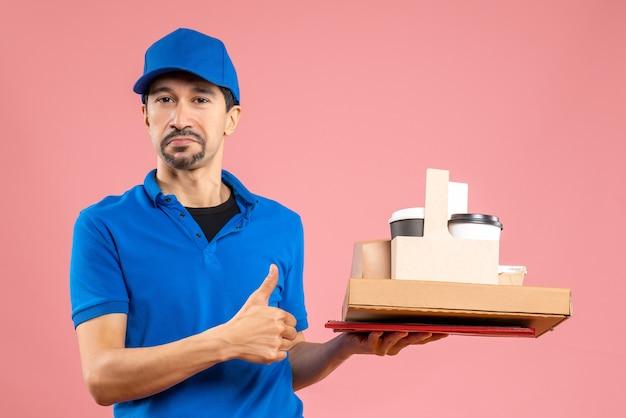 Vista frontal de um entregador ambicioso usando um chapéu, mostrando pedidos e fazendo gestos de ok