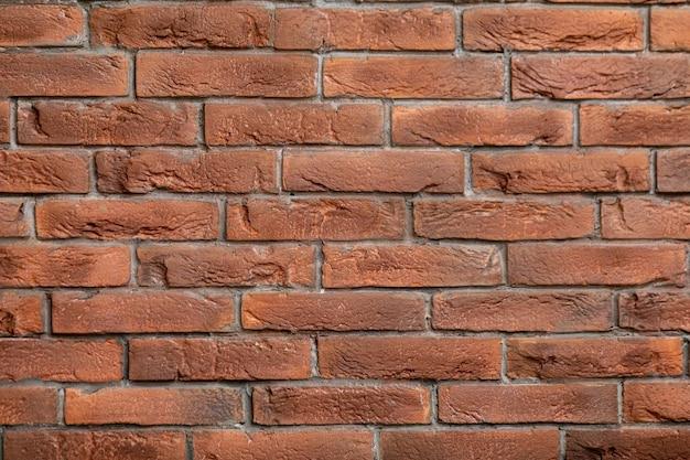 Vista horizontal do fundo da parede de tijolo marrom