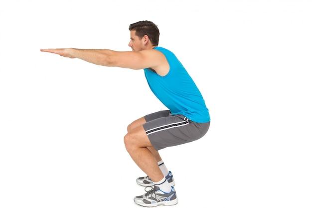 Vista lateral, de, um, ajuste, homem jovem, fazendo, esticando exercício