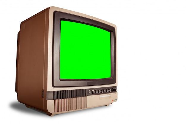 Vista lateral do velho receptor de tv em casa retrô com tela verde em branco com traçado de recorte