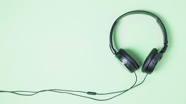Vista panoramic, de, pretas, headphone, ligado, turquesa, fundo