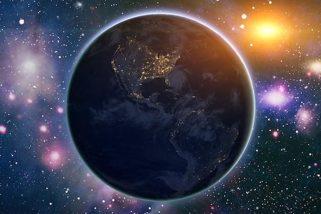 Vista panorâmica da terra, sol, estrela e galáxia. nascer do sol sobre o planeta terra, vista do espaço. elementos desta imagem fornecidos pela nasa