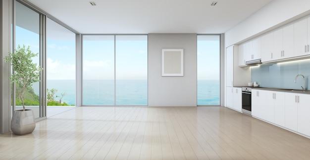 Vista para o mar cozinha de casa de praia de luxo com planta interna, perto da porta de vidro e piso de madeira
