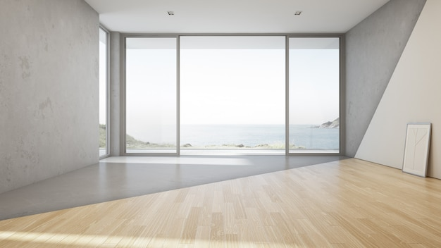 Vista para o mar grande sala de estar da casa de veraneio de luxo com piso de concreto vazio