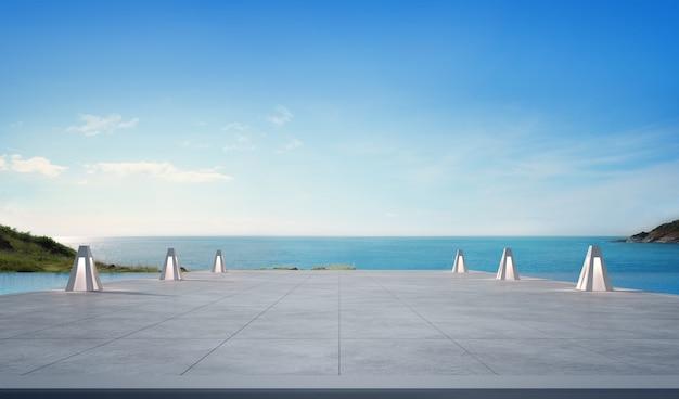 Vista para o mar piscina e terraço vazio na casa de praia de luxo moderno