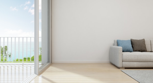 Vista para o mar sala de estar da casa de praia de luxo com mobília moderna perto da porta de vidro