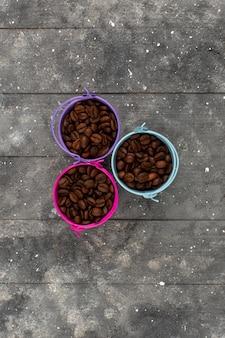 Vista superior, café, sementes, marrom, inteiro, dentro, colorido, potes, cinzento, rústico, madeira, chão