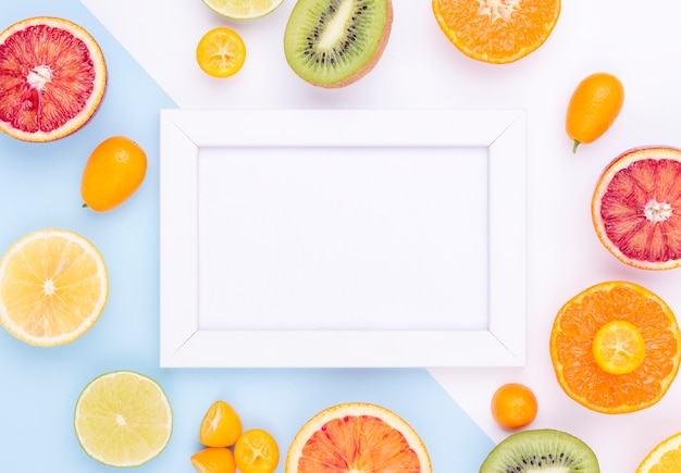 Vista superior coleção de frutas frescas com moldura