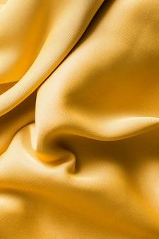 Vista superior conceito de textura de tecido dourado