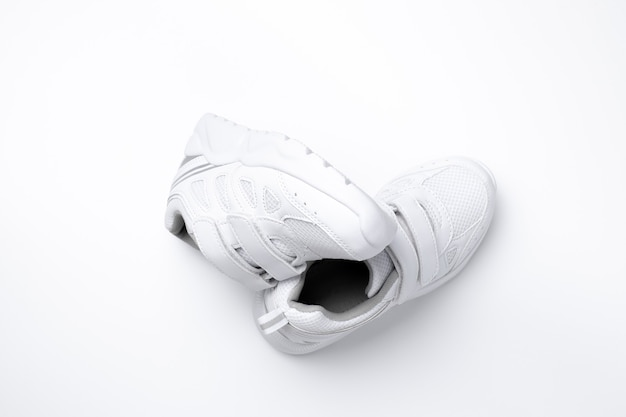 Vista superior conjunto de símbolo de tênis unissex branco de hábitos esportivos saudáveis e saúde isolado em um branco.