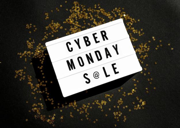 Vista superior da caixa de luz cibernética segunda-feira com glitter dourado