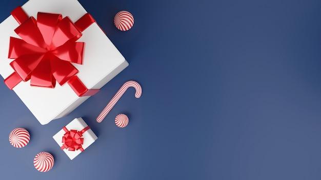 Vista superior da caixa de presente branca com fita vermelha, bola e doces. conceito de feliz natal e feliz ano novo. renderização 3d