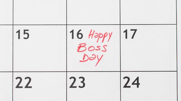 Vista superior da data do dia do chefe no calendário