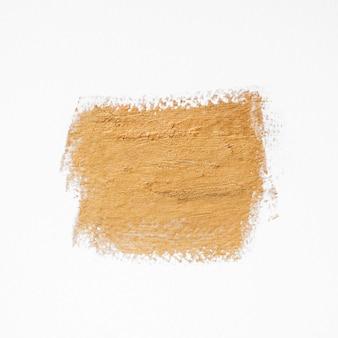 Vista superior da linha de tinta dourada