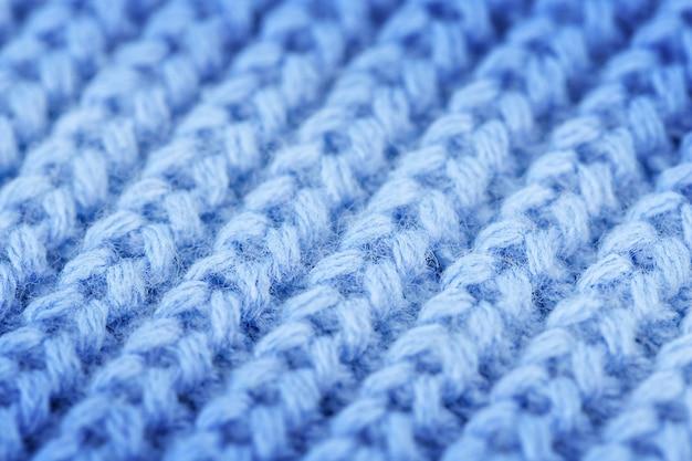 Vista superior da macrofotografia de fundo azul tricô