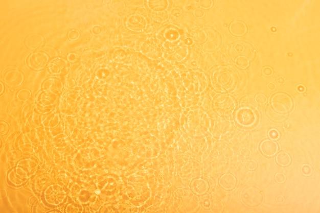 Vista superior da textura da água em laranja