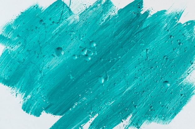 Vista superior das pinceladas de tinta azul na superfície