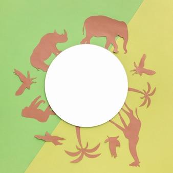 Vista superior de animais de papel com um círculo preto para o dia animal
