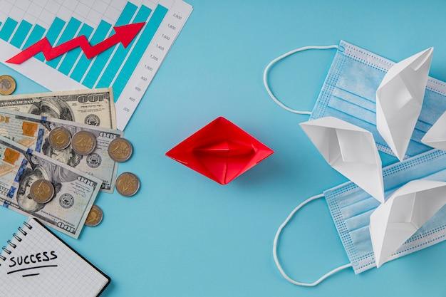 Vista superior de itens de negócios com gráfico de crescimento e máscaras médicas