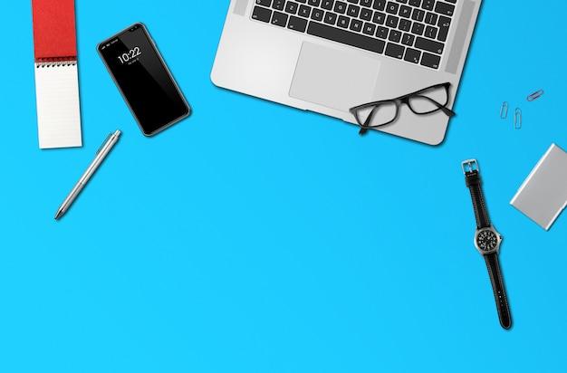 Vista superior de maquete de mesa de escritório isolada em azul