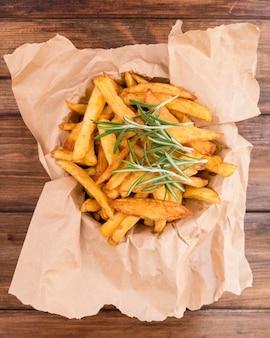 Vista superior deliciosas batatas fritas