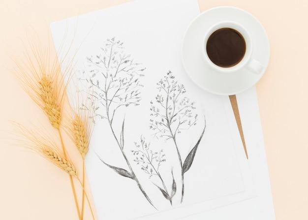 Vista superior, desenho a lápis e trigo com uma xícara de café