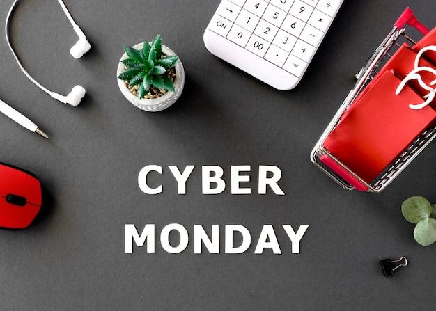Vista superior do carrinho de compras com sacolas e calculadora para cyber segunda-feira