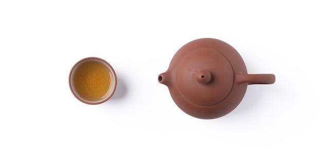 Vista superior do chá preto fresco com bule de chá e folhas em taiwan, layout de conceito de design de cultura asiática.