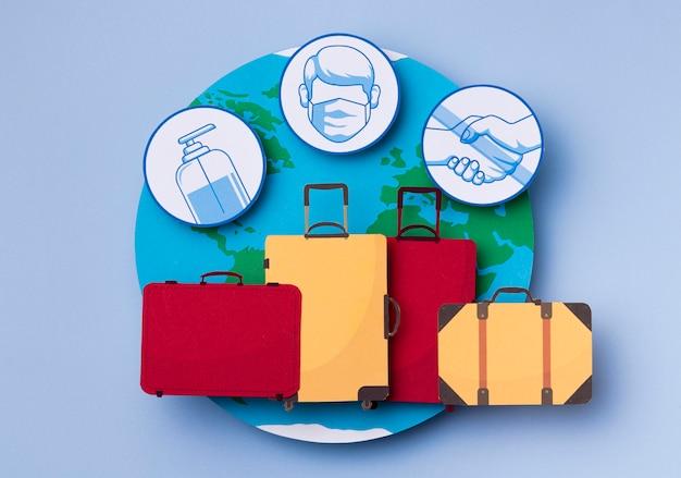 Vista superior do dia mundial do turismo com bagagem
