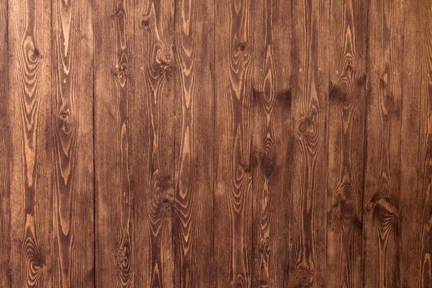 Vista superior do espaço de textura de mesa de madeira velha escura