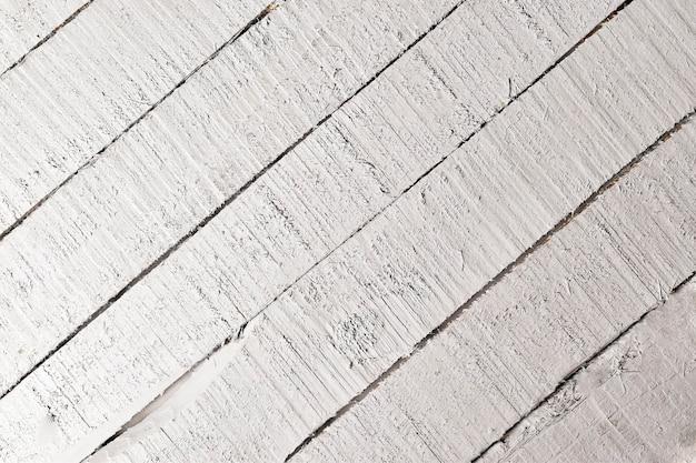 Vista superior do fundo branco de madeira colocado diagonalmente