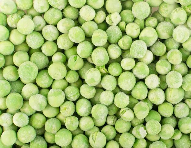 Vista superior do fundo de ervilhas verdes doces congeladas