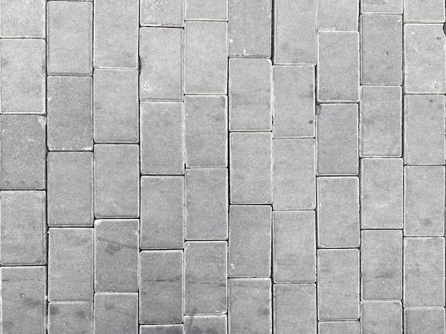 Vista superior do fundo do assoalho do caminho do caminho dos blocos de cimento cinza.